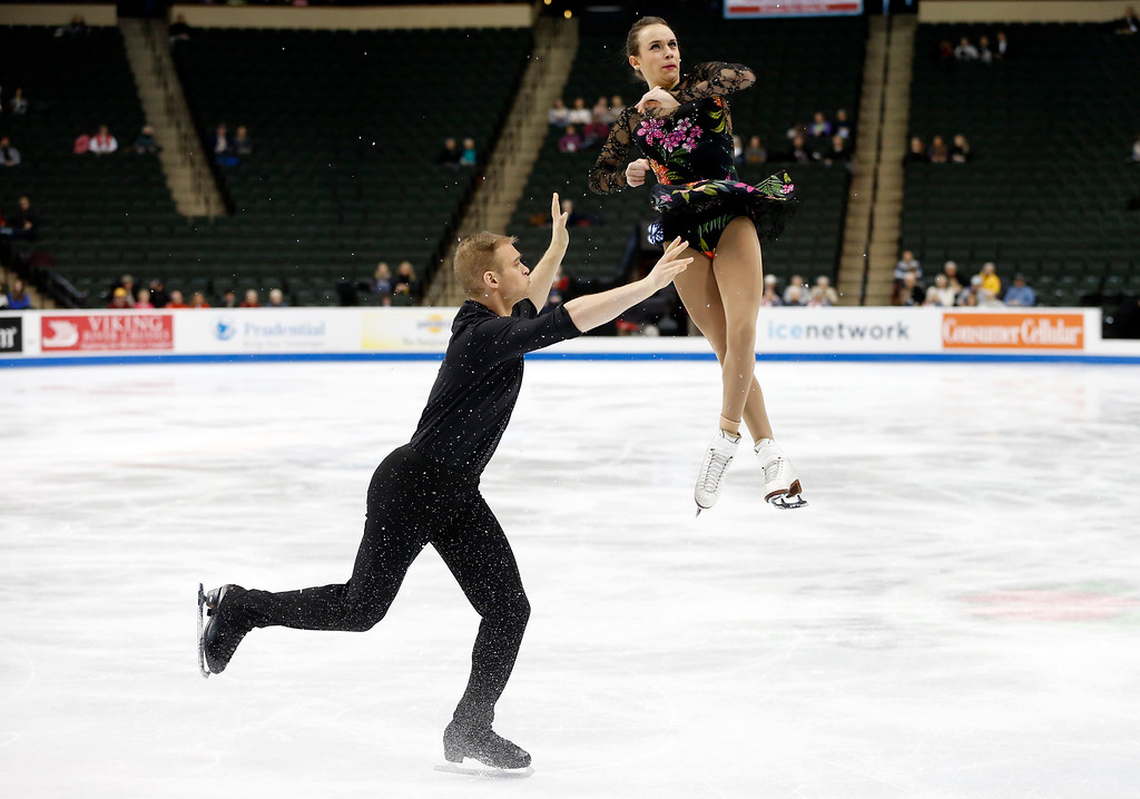. Pairs skaters Jessica Pfund, right, and Joshua Santillan perform in the short program of the U.S. Figure Skating Championships, Thursday, Jan. 21, 2016, in St. Paul, Minn. (AP Photo/Jim Mone)