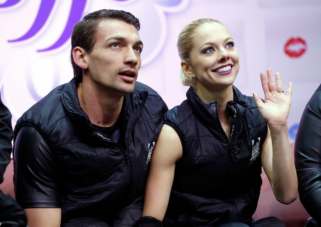 . Pairs skaters Alexa Scimeca, right, and Christopher Knierim acknowledge fans after the short program of the U.S. Figure Skating Championships, Thursday, Jan. 21, 2016, in St. Paul, Minn. (AP Photo/Jim Mone)
