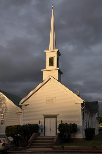 The late evening sun shines on the Sutter Creek Methodist Church