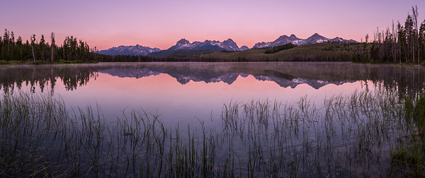 Sawtooth Mountains reflect in Little Redfish Lake, Stanley, Idaho