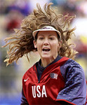 United States softball pitcher Michelle Smith's hair goes flying as she releases a toss against China Monday, Sept. 25, 2000 in Sydney. The United States beat China, 3-0. (AP Photo/Elaine Thompson)