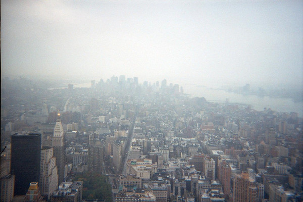 From the Empire State Building looking back toward where the WTC used to be. Note smoke still over skyline ground zero 9-11-2001 photo. This was a bright sunny day outside NYC.