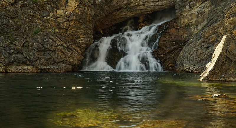 Running Eagle Falls. It goes through a cave
