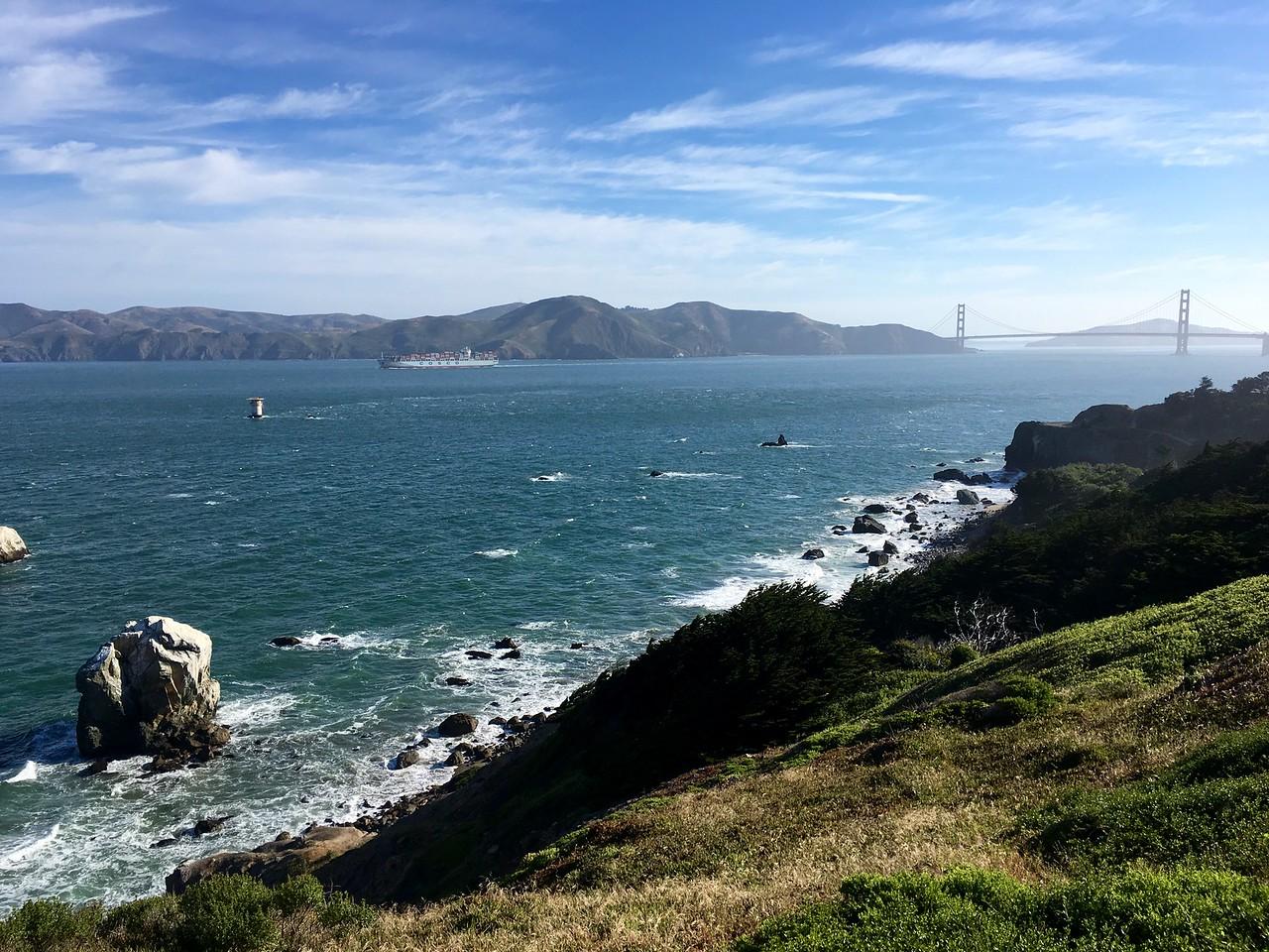 Lobos Rock, the bridge, and a container ship