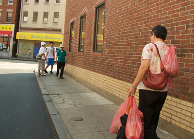 Boston Chinatown - Shopper with Plastic Bags