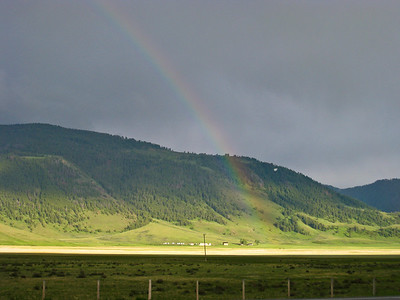 A rainbow appears over the National Elk Refuge buildings near Jackson, WY.