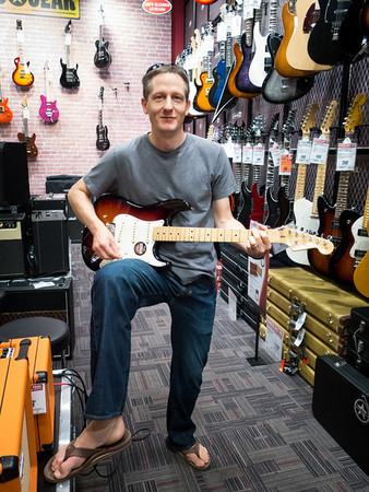 Paul test driving the Fender Stratocaster Electric Guitar (he got one)!