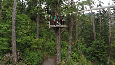 Susan approaches the final zipline landing platform