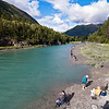 A lot of people fishing salmon in a creek close to the Seward Highway.