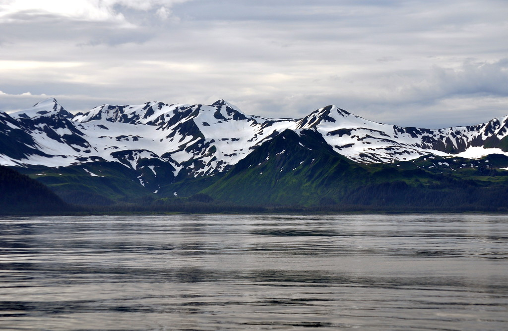 View of the mountains in Prince William Sound while fishing for Halibut one a fishing charter from Whittier Alaska