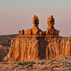 The Three Sisters, shot during a less than ideal sunset under partial light cloud cover.in Goblin Valley State Park, Near Hanksville, Utah.  This park is easily missed since it does not have the fame of many of UItah's other parks, but it is worth the visit for it's unique Goblin like sandstone formations. The Three Sisters, an Isolated line of hoodoos, welcomes you just inside the entrance to the valley.
