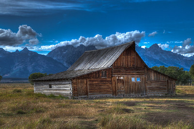 John Moulton's Barn, Mormon Row, Grand Teton National Park, Wyoming   Mormon Row may be one the most picturesque areas of Grand Teton National Park, with rustic, wooden buildings surrounded by open fields, grass and sage standing out against the stunning backdrop of the Tetons. For watching wildlife; taking a quick, easy walk; for seeing into the lives of the West's early settlers, a trip to Grand Teton National Park really isn't complete without a visit to Mormon Row. This image was processed in HDR using Photomatix Pro 4.   Mormon Row is located in Grand Teton National Park off of Antelope Flats Rd, about one mile east from Hwy 26/89/191. The Antelope Flats turnoff is just north of Moose Junction.