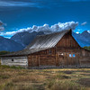 John Moulton's Barn, Mormon Row, Grand Teton National Park, Wyoming<br /> <br />  Mormon Row may be one the most picturesque areas of Grand Teton National Park, with rustic, wooden buildings surrounded by open fields, grass and sage standing out against the stunning backdrop of the Tetons. For watching wildlife; taking a quick, easy walk; for seeing into the lives of the West's early settlers, a trip to Grand Teton National Park really isn't complete without a visit to Mormon Row. This image was processed in HDR using Photomatix Pro 4.<br /> <br />  Mormon Row is located in Grand Teton National Park off of Antelope Flats Rd, about one mile east from Hwy 26/89/191. The Antelope Flats turnoff is just north of Moose Junction.
