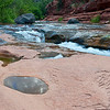 Reflections of Monsoon clouds and fast moving water at Slide Rock State Park.