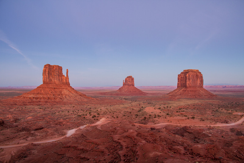 Monument Valley Navajo Tribal Park in Arizona nearing dusk.