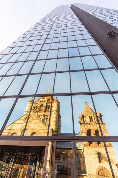 The Hancock, reflecting Trinity Church