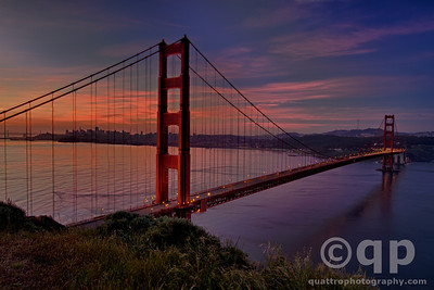 SUNRISE GLOW OVER THE BRIDGE