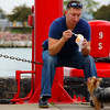 "A man sitting down eating ice cream while his hungry dog is salivating - Navy Pier, Chicago.  To view my travel gallery from Chicago click on the photo. <a href=""http://nomadicsamuel.com"">http://nomadicsamuel.com</a>"