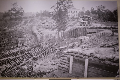 """Appomattox, VA Museum of the Confederacy - Rebel Works in Front of Atlanta, Ga., No. 1, 1864; printed 1866 Albumen print; 10 x 14 ¼ in. George N. Barnard embedded with the Army of the Cumberland in Nashville as Union Gen. William T. Sherman advanced toward Atlanta in May 1864. After Confederate forces evacuated the city, Barnard followed the path of Sherman's notorious """"March to the Sea,"""" which left a trail of devastation in its wake. In 1866, Barnard published Photographic Views of Sherman's Campaign."""