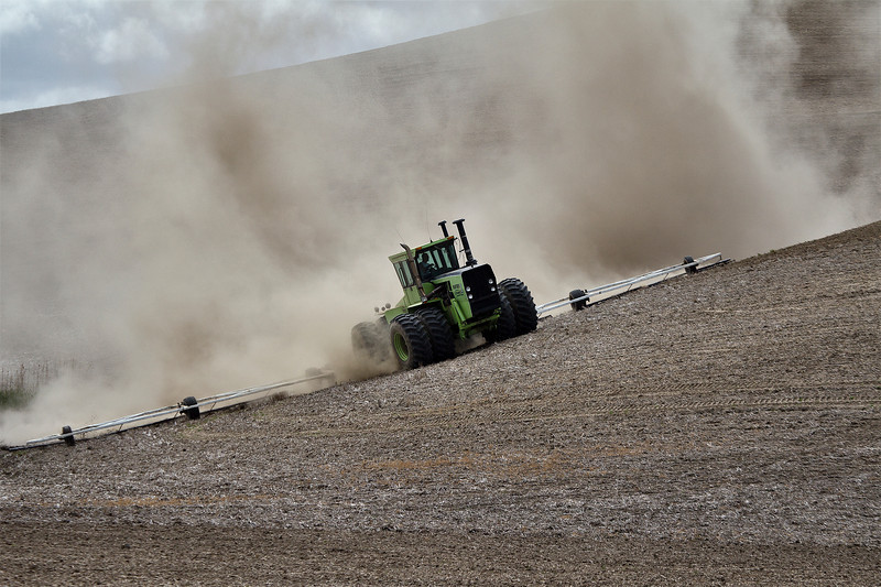 The Palouse, Washington. A farmer works his fields in preparation for the next crop.