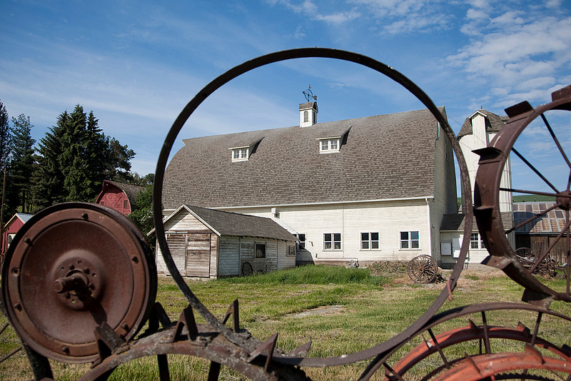 """With its fence constructed of over a thousand antique tractor and wagon wheels, the """"Wheel Barn"""" near Uniontown, Washington is a landmark in the Palouse region"""