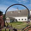 "With its fence constructed of over a thousand antique tractor and wagon wheels, the ""Wheel Barn"" near Uniontown, Washington is a landmark in the Palouse region"