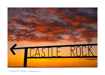 Sign to Castle Rock at sunrise, KS
