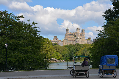 Couple of pedicabs overlooking the Central Park Boating Lake