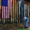 The Moravians set up camp at Old Bethabara in Winston-Salem, NC, and this colonial woman opening a large shed to store covered-wagons represents the door opening to new settlers in America in the 1700's.