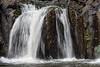 Close-up-of-small-waterfall,-Lili'uokalani Botanic-Garden,-Honolulu,-Oahu