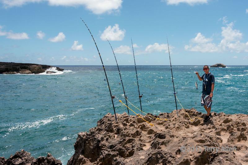 Big-fishing-rods,-small-fish,-La'ie-Point,-Oahu