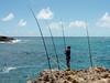 Tending-the-fishing-lines,-La'ie-Point,-Oahu