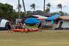 Three-girls-going-sea-kayaking,-Kualoa-Regional-Park,-Oahu