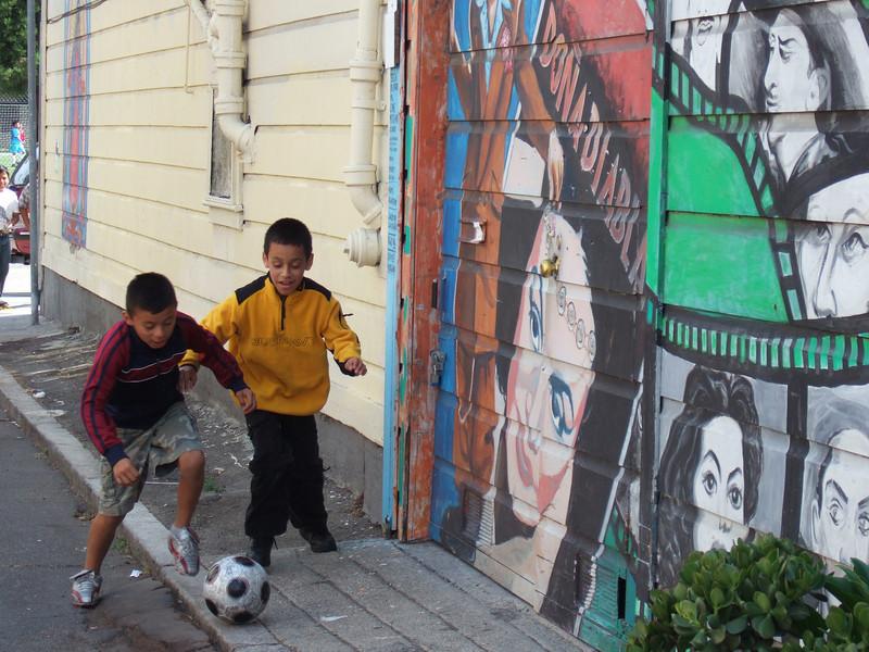 Kids playing soccer at Balmy Street....