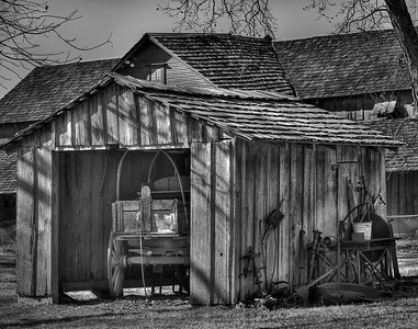 Rustic shed with wooden wagon