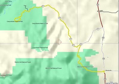Départ à 6h50 de Monticello. Monticello est à 2148m d'altitude Nous arrivons à Chesler Park, au départ de la Rando, vers 8h15, en ayant parcouru 82 km d'une route fabuleuse, dans la montagne, c'est la  Hart's Draw Road, qui monte à travers les Abajo Mountains. On voit 2 cerfs, des biches, un coyote.Il faut dire que nous sommes aussi en bordure de la Manti_La Sal Forest. Puis la route suit l'Indian creek, (211) entre deux montagnes presque dignes du Grand Canyon.( c'est la Indian creek scenic byway)