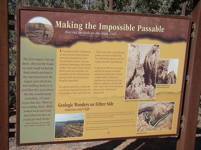 "cette route a toute une histoire,  The trail was constructed by Mormon pioneers during the winter of 1879- 80. In contrast to most new trails this one was built from west to east rather than from east to west. The trail was to be a ""short cut"" between Escalante and Bluff. At that time the only alternative routes between those points ran clear to the north through Green River or clear to the south through Arizona. The Mormon's wished to establish a colony in the four corners vicinity which had become a hide out for lawless Indians and whites. They expected their mission to take about 6 weeks which would have put them in Bluff before winter. Instead it took 6 months including a very vicious Utah winter. The biggest obstacle was getting down the west side of the Colorado River which was accomplished at the Hole in the Rock after months of blasting and road building hand work. The trail there dropped at approximately a 45 degree angle for a quarter of a mile or about a third of the distance down to the river and was barely wide enough for their wagons. The total drop was 1,800 feet in less than a mile. The pioneers did not ferry the Colorado and begin the section of the trail to the east until late January. The river froze over completely a few days after the last wagons were ferried across. The section of the trail on the east side of the Colorado now known as the Hole in the Rock 4WD trail was opened by the Mormon Pioneers in February of 1880."