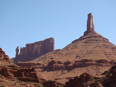 "The famous ""Priest and Nuns"" red stone sculpture (left) stands well over a thousand feet off the Valley floor. Castle Rock (right) is an excellent example of the hundreds of giant monoliths in this area up stream on the Colorado River from Moab, Utah."