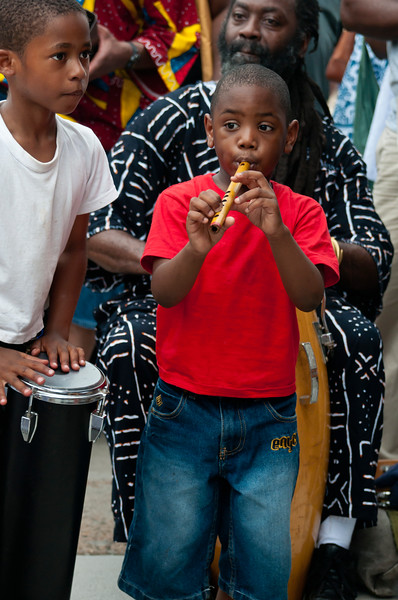 Boys join drum circle at Odunde festival, Philadelphia, Pennsylvania