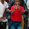 Boys join drum circle at Odunde festival, Philadelphia, Pennsylvania