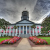 The original Old Capitol building in Tallahassee, Florida dates back to 1845.  This small building has been restored to how it looked in 1902.  It is dwarfed by the large, new capitol complex behind it to include a 22-story building.