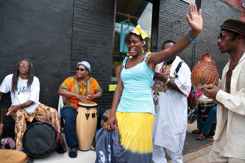 Dancer and drum circle at Odunde festival, Philadelphia, Pennsylvania