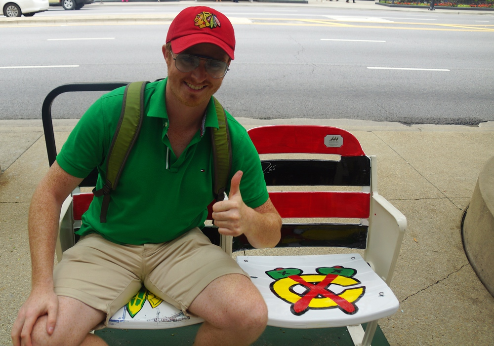 Sitting down on a Chicago Blackhawks chair along the Magnificent Mile