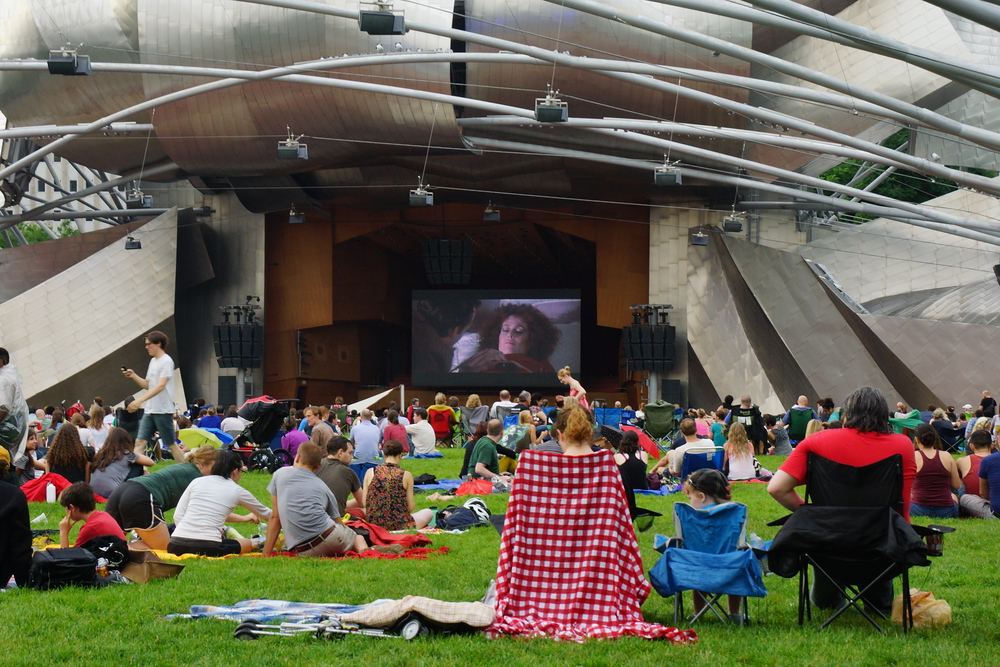 Watching a free movie outside at the Pavilion nearby Millennium Park