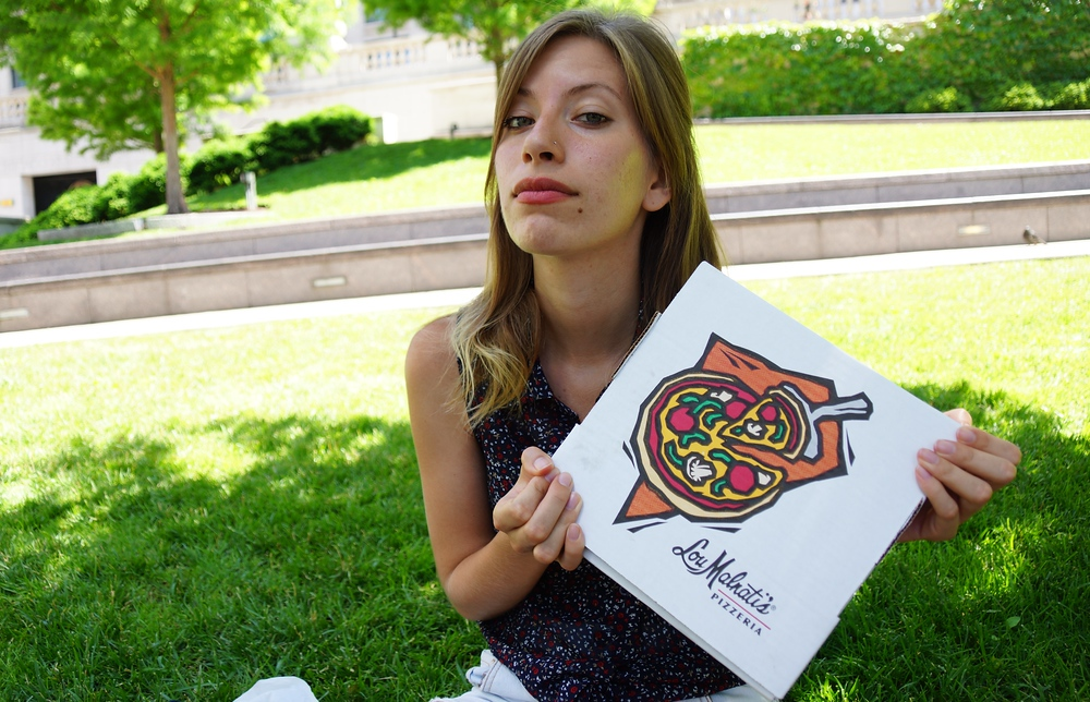 Audrey Bergner of That Backpacker posing with Chicago Deep Dish Pizza from Lou Malnati's