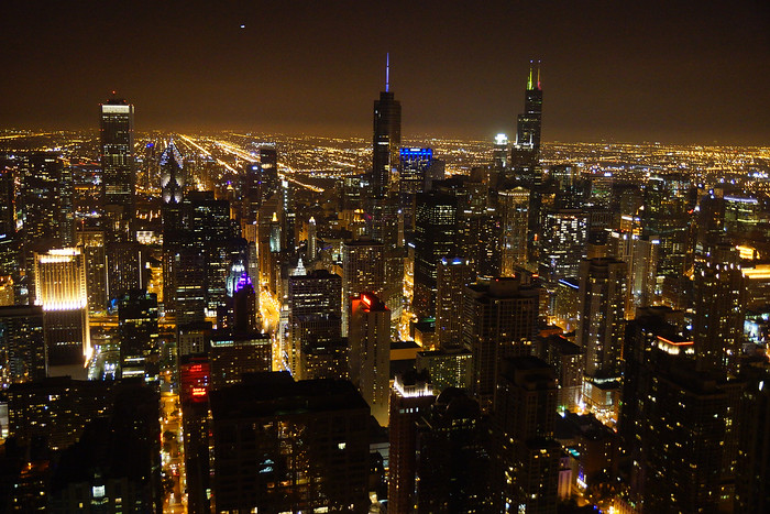 The Chicago skyline at night as seen from the John Hancock Center.