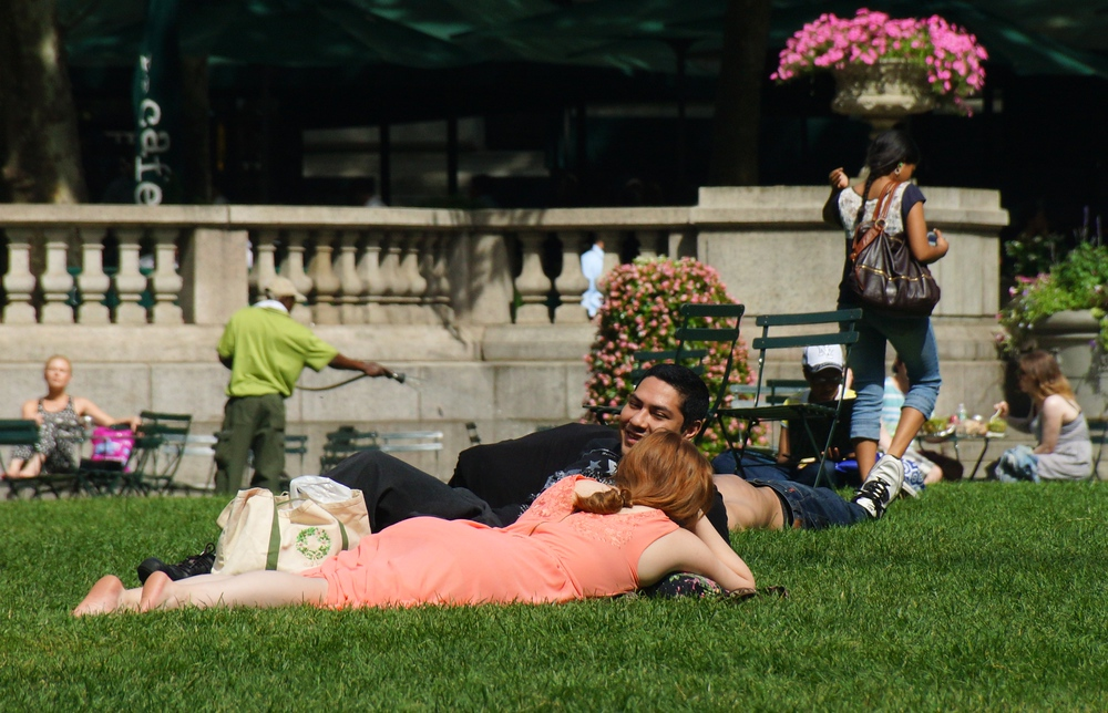 People lying on the grass at Bryant Park in New York City