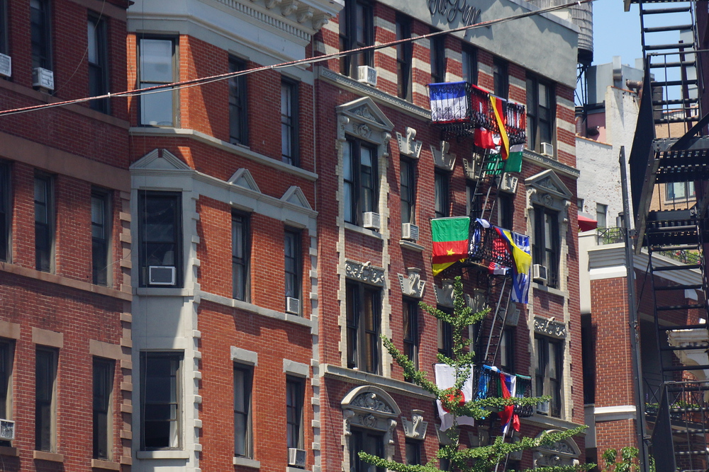 World Cup soccer flags hanging from an apartment building in DUMBO, Brooklyn New York City