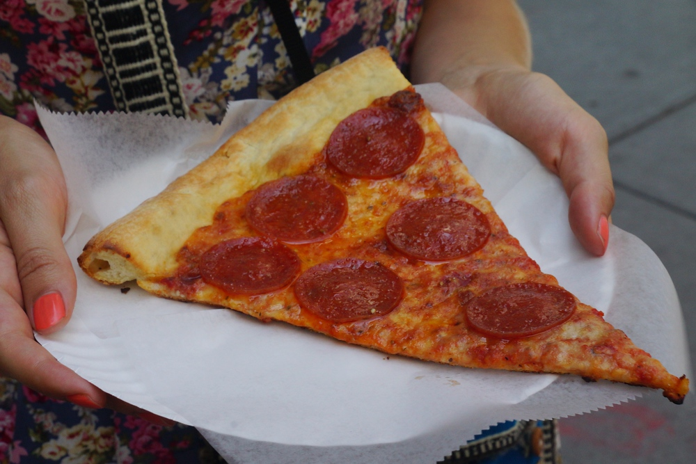 Eating a slice of New York style pizza in Brooklyn