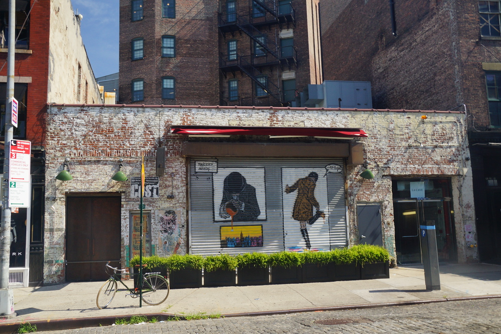 Photo of some closed stores and a bicycle in the Meatpacking District of New York City